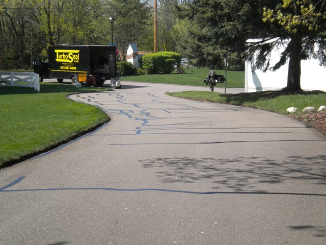 Crack filling before driveway sealcoating