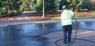 spraying driveway sealcoating